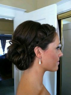 Bridesmaid hair but with a few strands of hair down around the ears