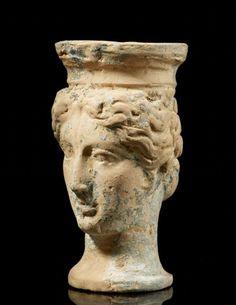 AN OFFERING STAND REPRESENTING A FEMININE HEAD, MAGNA GRECIA, 4TH-3RD CENTURY B.C.