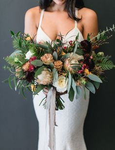 Lush boho bouquet with marigold flowers, antique roses, and ferns
