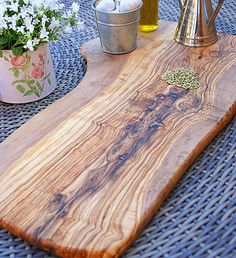 ❤ the grain pattern on this olive wood cutting board...Large 50cm Natural Olive Wood Serving Board by The Rustic Dish £49.50