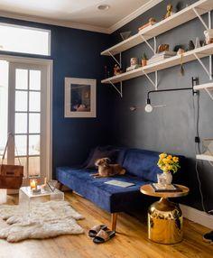 Navy sofa, bronze side table, gray walls, white shelving, FRENCH DOORS...DOGGO...okay I need to take a deep breath now