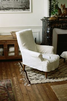 For the home's main rooms, slipcovers were fashioned from old linen sheets. All the original pine floors and molding were preserved.