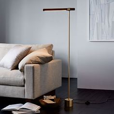 """The slim frame of our Linear Wood Floor Lamp shines a spotlight on modern style. It's equipped with an integrated, long-lasting LED light—that means you'll never have to replace another lightbulb again. • 18""""w x 6""""d x 46""""…"""