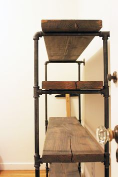 plank shelves using plumbing pipes and joints