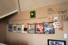 clothesline on wall to clip photos and artwork.  Good for revolving kid art on display.