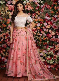 Apr 2020 - Pink Floral Embroidered Organza Lehenga features a net embellished blouse, organza lehenga with santoon inner and organza dupatta. Embroidery work is completed with thread and lace embellishments on this style. Lehenga Crop Top, Floral Lehenga, Lehenga Style, Lehenga Blouse, Pink Lehenga, Kids Lehenga Choli, Indian Gowns Dresses, Indian Fashion Dresses, Dress Indian Style