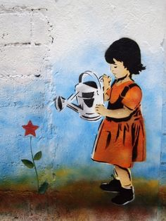 """Watering socialism."" Street art from Venezuela's Guerrilla Comunicacional collective."