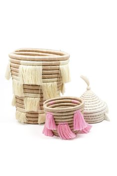 "Using locally grown sweetgrass, artisans based in Rwanda create this practical and unique basket. Perfect for making home organization a little more enjoyable! Dimensions: Measures approximately 5"" x"