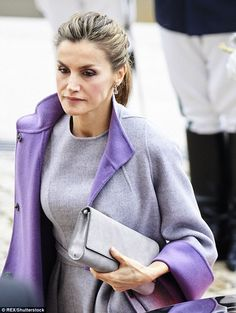 Colour coorindation: Letizia kept her makeup simple, adding just a slick of lipstick and s...