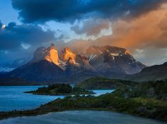 The Cuernos (Horns) del Paine grab the early morning light in Chile's wild Torres del Paine National Park. Once the haunt of a few stalwart climbers, the park now draws more than 100,000 visitors a year. Photograph by Gleb Tarro, National Geographic Your Shot, February 17, 2015