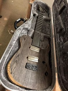 Sabre Guitars  Spur HB-7 swamp ash and black limba.