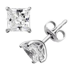 These classic princess cut stud earrings are made of sterling silver and are rhodium plated. Stone measures approximately 3 1/2 carats.