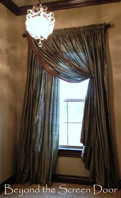 Cascading Swag Window Treatment made from store bought curtains, fringe and a bit of alteration.  Beyond the Screen Door
