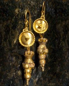 A pair of Roman Shield & Grape Earrings, ca 1st century AD