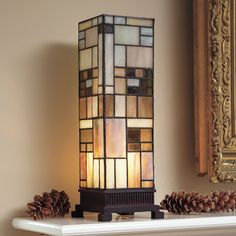 "Arts and Crafts Stained Glass Lamp A pillar of light in warm earth tones. Lamp is crafted in classic Tiffany style, with 134 pieces of hand-cut stained glass joined by copper foil. Cast resin base. 5""w x 14""h x 5""d. Inline switch. Takes a 40-watt candelabra bulb."