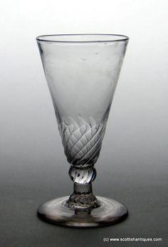 Georgian Petal Moulded Ale Glass c1770 Origin : English Bowl : Pointed round funnel Bowl Features : Petal moulded lower bowl; twisted wrythen style Stem : Knopped Stem Features : shoulder knop and basal knop, defined rib moulding continues from the petal moulding over both knops and stem Foot : Conical Pontil : Snapped Size : 4 9/16 inches tall with a 2 3/8 inch bowl and 2 3/8 inch foot  http://scottishantiques.com/Georgian-drinking-glasses/ale-beer-glass?product_id=6014#.V7GyV1srJeg