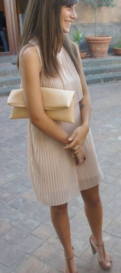 Nude pleated dress. Conservative, but elegant. Love the shoes