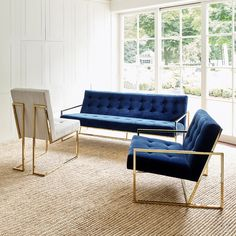 Minimalist Comfort. Pared down geometry in polished brass meets swanky navy velvet in Jonathan Adler's Goldfinger Collection.