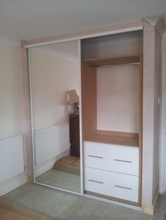 Fitted wardrobes with sliding mirror doors and MDF fitted interior