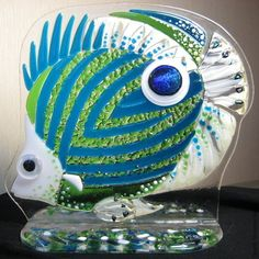 Tropical fish 'Peacock eye'. In the blue-green colors with a bright gold. Painted with fire-resistant paints. Glass art by Elena Nechayeva