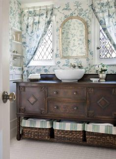 antique buffet cabinet turned into a bathroom sink. Generally really do not like it when people modernize, paint or change antique, but this looks good so oh well...