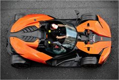KTM X-BOW GT.   The functionality is mostly wrapped up in more streamlined colored bits. the contrast defines the form and puts an interestingly noticeable gap between form and function.