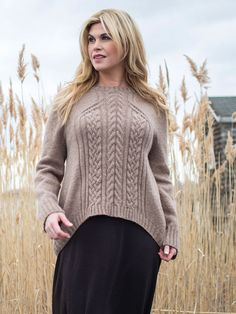 A cable panel on the front, a sloping hem on the back, this pullover is worked top down with clever faux set in sleeve shoulder shaping. Cable pattern is charted.