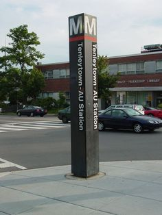 Tenleytown-AU is the last station wholly within the District of Columbia, before the Red Line enters Montgomery County, Maryland.  As its name indicates, Tenleytown-AU serves the neighborhood of Tenleytown, and American University, part of which is situated at Tenley Circle and whose main campus is located roughly one mile south of the actual station. The University operates a shuttle bus between main campus, the Washington College of Law, and the station.  Service began on August 25, 1984.