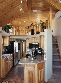 .I think this is a tiny house it just has a very high ceiling making it look like a regular house