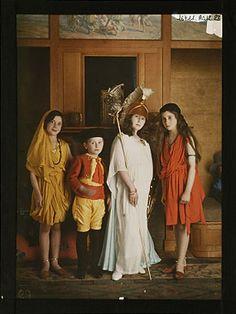 Autochrome: Four children's costumes: one oriental, bullfighter, Athena and a bohemian, circa 1921, Salon du goût français.