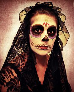 Dia de Los Muertos.  Shown for the ruffle-like use of sheer black cloth together with traditional black lace for the mantilla.
