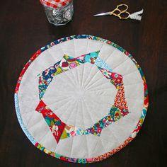 Liberty Art Fabrics Mat by ♥rashida coleman-hale♥, via Flickr - love the fabrics, love the circle, love the improv triangles.