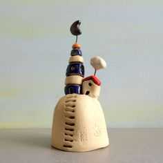 This is a one of a kind miniature of a ceramic lighthouse and a miniature house. Both are handmade ceramics standing on a clay hill. Above them, there are a little moon and a little cloud hanging! I see this as if it came out of a fairy tale book. Am looking for the princess to show at one window, waiting for her prince charming... Can you see it too? Anyway, this clay house and lighthouse, will make a wonderful ceramics and pottery birthday gift for him, for her, for a childs room! It will…