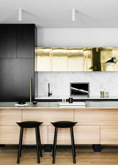 Brass accent cabinets give the kitchen a unique touch