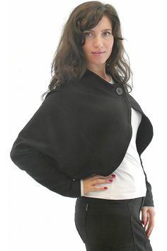 Women knitted bolero, which has one button on the cleavage. The bolero is with long sleeves. The model is with free cut and asymmetrical bottom part. The bolero is worn with folded neckline.