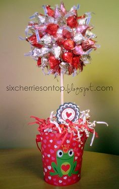 Hershey Kiss Topiary. Made this for my son's 3rd grade teacher. Used heart shape jar with matching lid. very cute little keepsake gift.