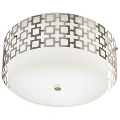 The Parker, Johnathan Adler perfection. This one of a kind three light flush mount is part of the Parker Collection of lighting fixtures. A unique decorative light, it features a white frosted cased glass shade with perforated metal covered in a polished nickel finish. This unique flush mount will add personality to any room.