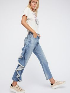 Estella Side Ruffle Jean | American made premium denim jeans featured in an ankle flare silhouette featuring a statement side ruffle detail.    * Rigid denim   * Raw trim   * High-rise   * Five-pocket style   * Button closure and zip fly