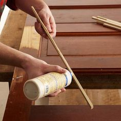 Step 4 - To fill any gaps or visible channels in the door, use wood glue to adhere strips of wood cut to fit.