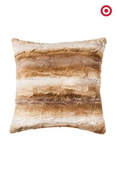 Cozy up to this season's faux fur trend with a decorative pillow—it's one of the easiest ways to add a warm, luxe feel to any room.