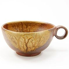 Bizen Yaki Pottery large Coffee Cup 'Cafe Au Lait Bowl' Size : Diameter 14cm×H7cm  Material : Pottery from Okayama Prefecture  For Cafe Au Lait, Soup,Salad  Dishwasher : No  Hand Made  Features of Bizen Ware  Bizen ware (Bizen-yaki is a type of Japanese Pottery most identifiable by its significant hardness, reddish brown color, absence of glaze (though there can be traces of molten ash looking like glaze), and markings resulting from wood-burning Kiln firing.