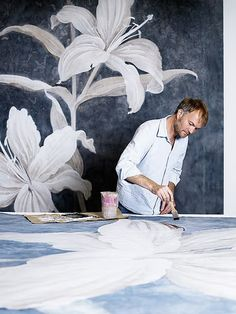 A man painting huge poofy blooms... good Lord I'm in heaven!! Sheer loveliness!! Artist Wouter Dolk//