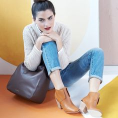 Neutrals are like best friends – it's more fun to have a bunch at once. Medium-wash denim, cognac booties, a black bag, and an oatmeal sweater in perfect harmony.