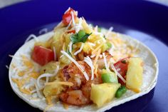 Shrimp tacos with pineapple salsa. These are delicious.  Just made them (without the cayenne pepper) & everyone loved them.