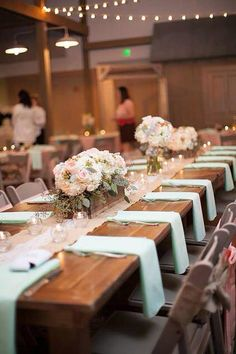 Peach and mint green wedding decor. Farm tables and wood box centerpieces.