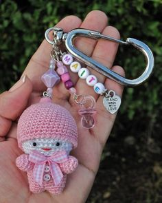 Definitely a fun way to while away the afternoon and you also get to use up the pieces of yarn you have left over from your other projects. Crochet Gifts, Crochet Dolls, Cute Crochet, Knit Crochet, Crochet Flower Patterns, Crochet Flowers, Crochet Keychain, Baby Girl Crochet, Crochet Accessories