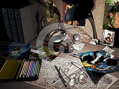 On a table enlightened by a lamp, colour  pencils, illustrations, comic, glasses, oil   painting tubes,  an inkwell, draw  sketches,   photos and illustrations stuck  on the wall: the place of an illustrator.