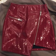 Cotton Candy Red Faux Leather Skirt This cherry red mini skirt is hot. It is new with tags and has never been worn. Zipper in front and in pocket. You will love it! Cotton Candy Skirts Mini