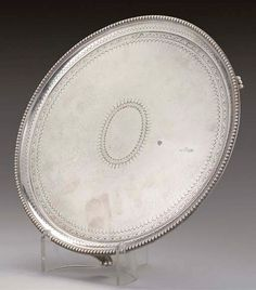 DUTY DRAWBACK MARK:- A GEORGE III SILVER SALVER, | MARK OF JAMES YOUNG, LONDON, 1785, | Christie's London, Silver, London England, Money