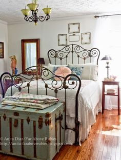 Love this boho inspired bedroom. Metal bed with turquoise trunk for storage.